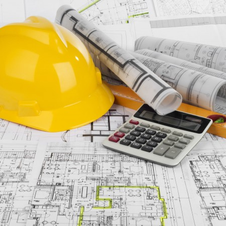 35996532 - yellow helmet, calculator, level and project drawings